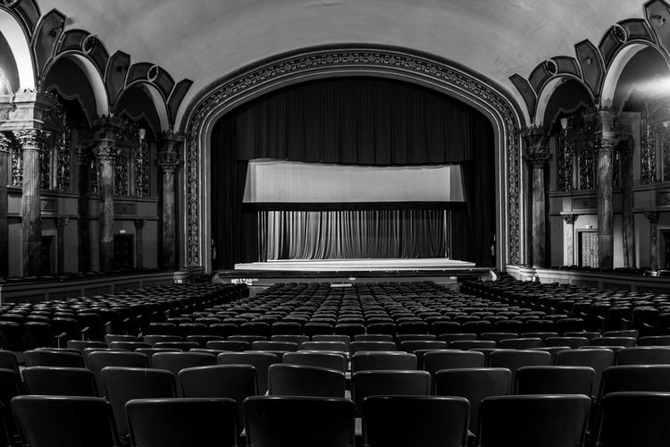 Empty seats in building theater bnw