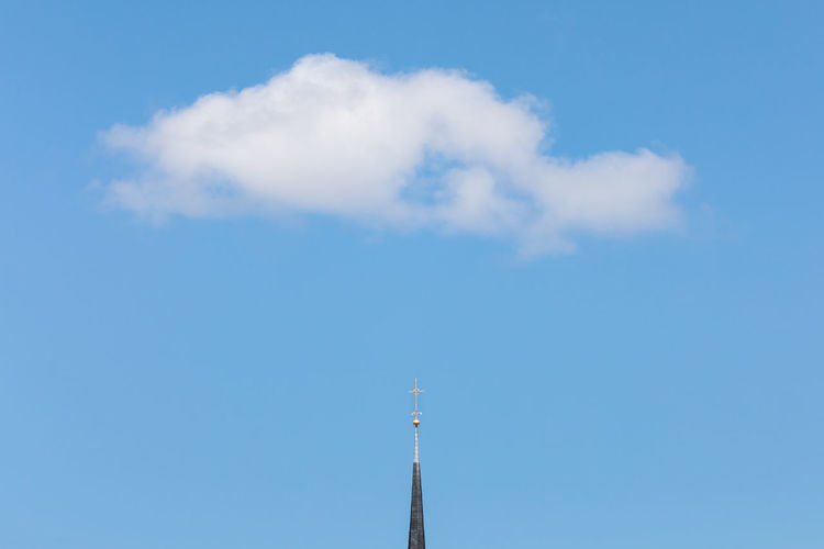 Single cumulus cloud over rooftop of a church with a golden cross Architecture Blue Christianity Church Cloud - Sky Cross Cumulus Cloud Day Gold Colored Heaven High Section Low Angle View Nature No People Outdoors Place Of Worship Religion Roof Simplicity Single Object Sky Spirituality Sunny Tall - High Weather The Architect - 2017 EyeEm Awards