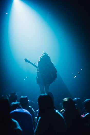 Silhouette woman performing on stage