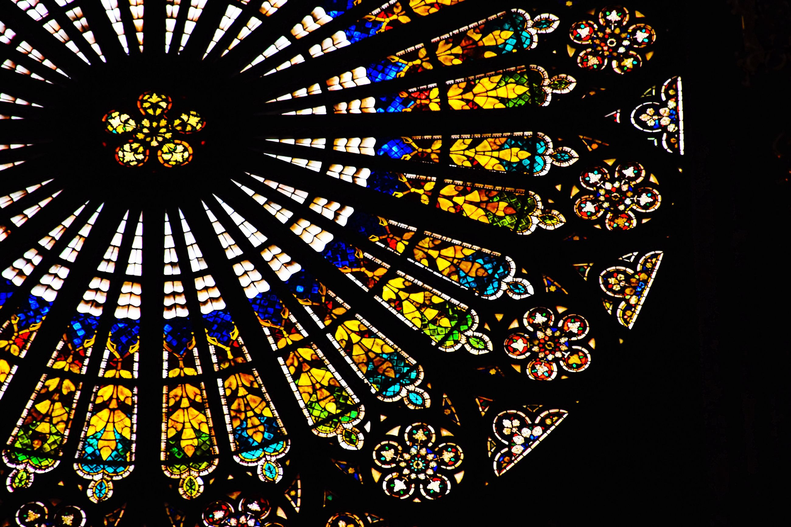 stained glass, glass, indoors, multi colored, design, pattern, architecture, shape, no people, geometric shape, built structure, place of worship, window, low angle view, religion, art and craft, circle, belief, ornate, spirituality, ceiling, floral pattern, directly below, architecture and art