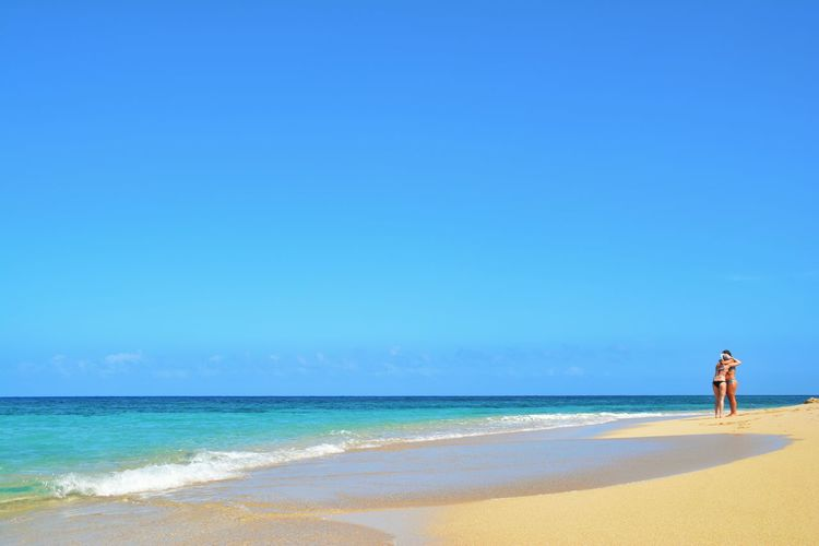 Sea Beach Horizon Over Water Sand Water Outdoors Vacations Travel Destinations One Person Day Leisure Activity Sky Clear Sky Full Length Scenics Nature People Adults Only Adult Beauty In Nature