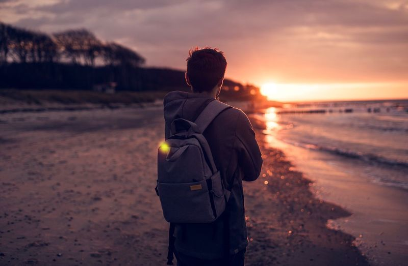 Sunset. Sunset Beach Sea Nature Sky Sand Standing Vacations Men Water Wave Ostsee Baltic Sea Sunlight Backpack Dark Hair Orange Light Outdoors Beauty In Nature Adventure Upper Body Be. Ready.