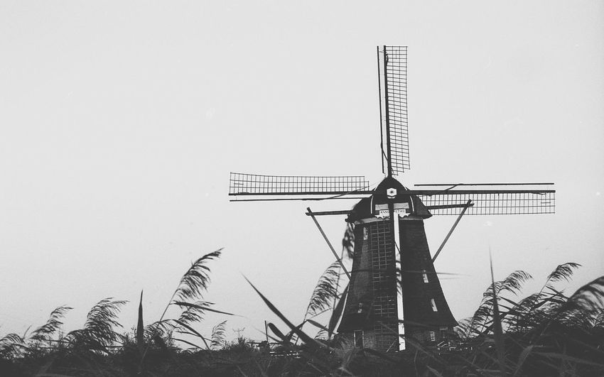 Kinderdijk molens, Molenwaard (Rotterdam). No People Notechnology Outdoors Wind Power Sky Architecture Windmill Built Structure Noir Et Blanc Walking Around BW_photography 35mm Film Photography Filmsnotdead Filmisalive EyeEmNewHere The Week On EyeEm Travel Destinations Travelling Travel Photos Travel Photography Enjoying Life Old City Day Building Exterior Panorama Lost In The Landscape Black And White Friday
