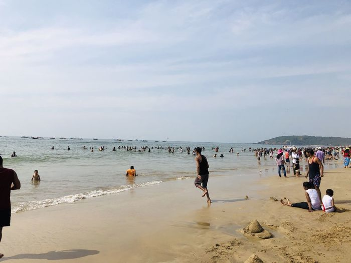 CALANGUTE BEACH,GOA Beach Sea Land Group Of People Water Crowd Sky