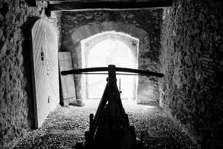 Rear view of cross in tunnel