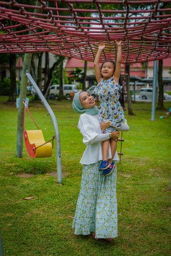 Full length of happy girl standing on grass