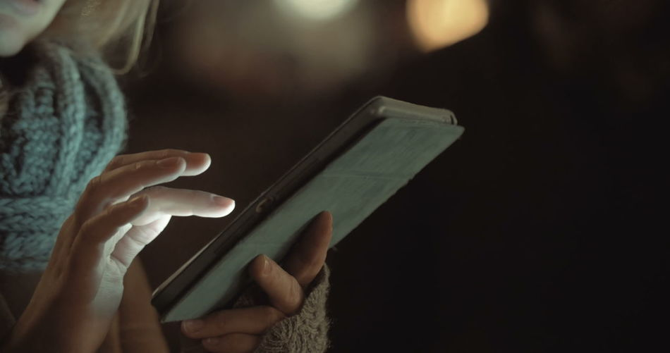Close-up of hand using mobile phone