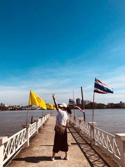 Patriotism Sky Real People Water Flag Lifestyles Nature