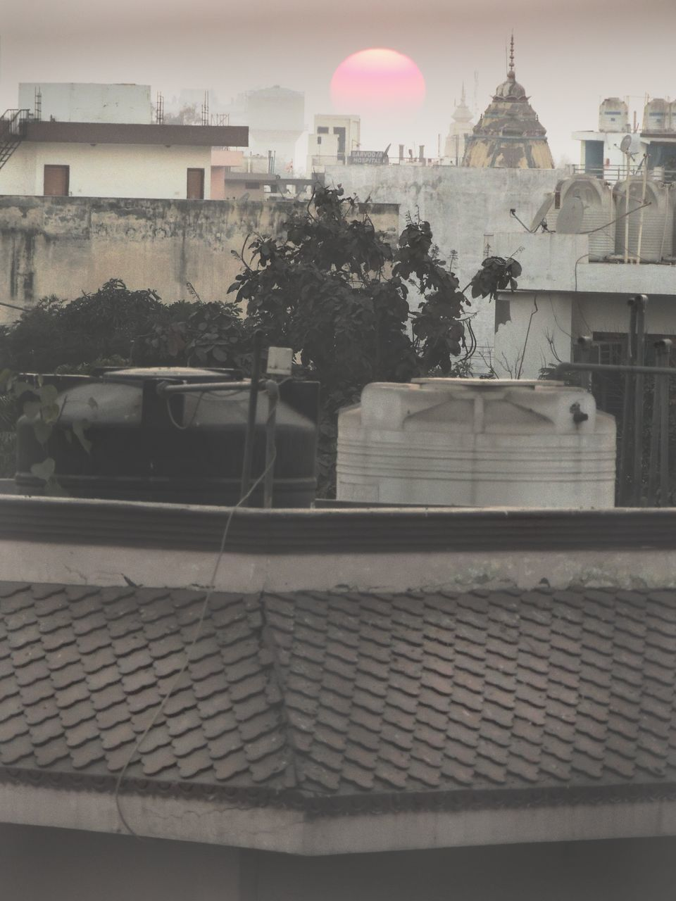 High Angle View Of Water Storage Tanks In Building Terrace