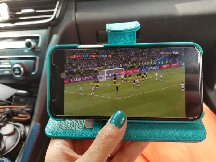World Cup on the go My Blue Obsession Teal Human Hand Hand Real People Human Body Part One Person Communication World Cup 2018 Technology Lifestyles Personal Perspective Wireless Technology Leisure Activity Vehicle Interior Car Finger The Fashion Photographer - 2018 EyeEm Awards Love The Game A New Perspective On Life Humanity Meets Technology