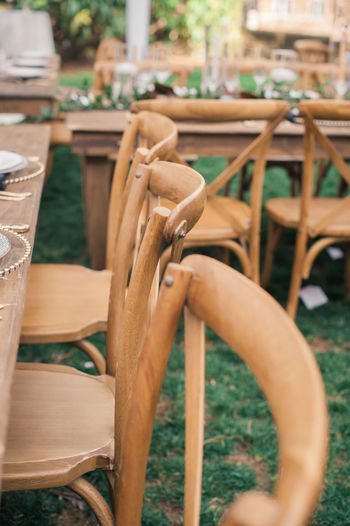 brown farm chairs at a reception table. Farm Life Wedding Reception Absence Brown Brown Chair Brown Color Chair Close-up Day No People Outdoors Seat Table