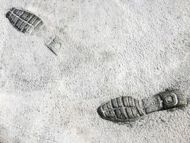 Footprints (Shoes) in Cement Road Foot Footprints Hard Walk Backgrounds Close-up Day Dry No People Outdoors Rough Shoesprint Texture
