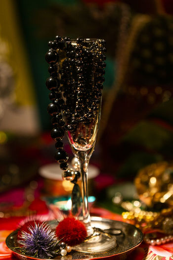 A Glass of Pearls Pearls Glass Reflection Black Pearls Jewelry Abundance Wealth Celebration Reflections Decoration Close-up Indoors  Focus On Foreground No People Luxury Selective Focus Pearl Jewelry Holiday Food And Drink Table Necklace Alcohol Still Life Ornate Precious Gem