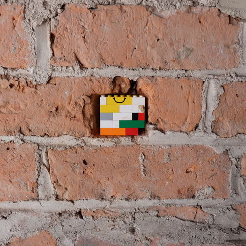 Low angle view of toy on brick wall