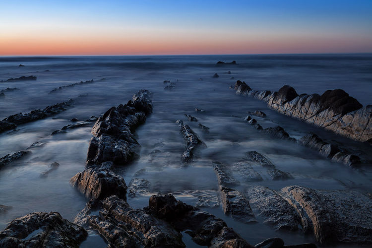 Long exposure image on the Barrika Beach in Basque Country, Spain. Background Beach Beautiful Beauty In Nature Blue Cloud Color Dark Dusk Evening Idyllic Landscape Long Exposure Nature The Great Outdoors - 2016 EyeEm Awards Outdoors Remote Scenics Sea Silky Sky Smooth Sunset Tranquil Scene Nature's Diversities