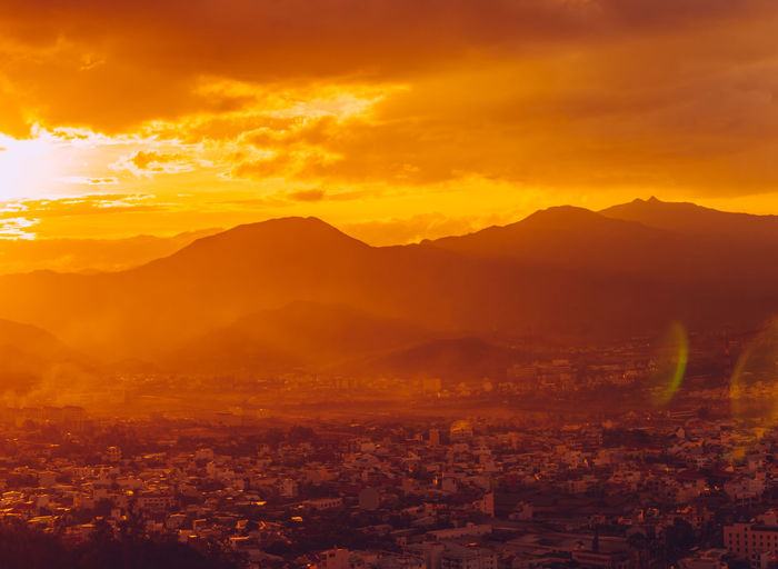 Nha Trang cityview on sunset Beauty In Nature Cityscape Cloud - Sky Dramatic Sky Environment Landscape Mountain Mountain Range Nature No People Non-urban Scene Orange Color Outdoors Scenics - Nature Sky Sun Sunlight Sunset Tranquil Scene Tranquility Yellow Capture Tomorrow