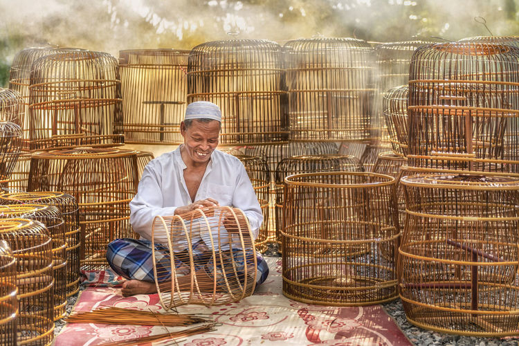 Art And Craft Thailand Adult Basket Birdcage Cage Countryside Craft Cultures Day Handmade Holding Lifestyles Males  Occupation One Person Outdoors Ratten Real People Senior Adult Senior Men Sitting Smiling Wood - Material Working