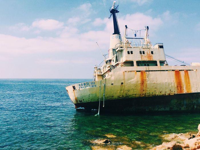 Shipwreck In Sea Against Sky