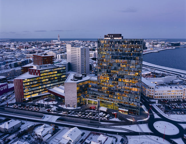 High angle view of buildings against sky in city during winter