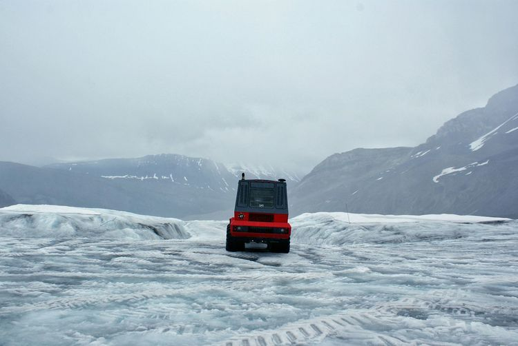 Snow Winter Mode Of Transport Cold Temperature Mountain Travel Destinations Outdoors Remote Global Warming Ice Age Athabasca Glacier Columbia Ice Fields Glacier White Color Snowcapped Mountain Weather Winter Travel Frozen Sky