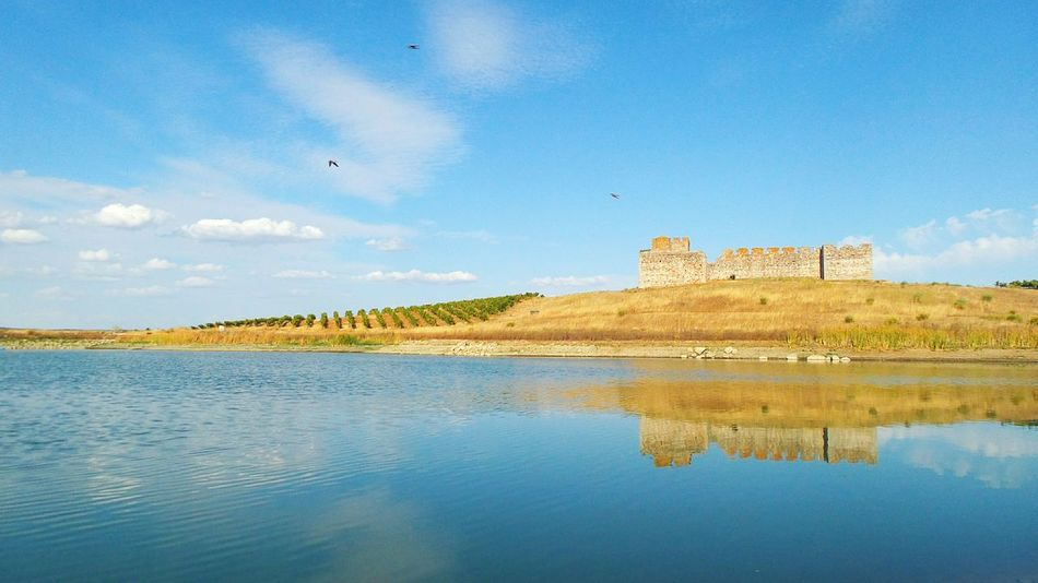 Valongo castle, south of Portugal. Lake Valongo Portugal Monument Old Castle Wall clouds Sky field Vineyard reflection