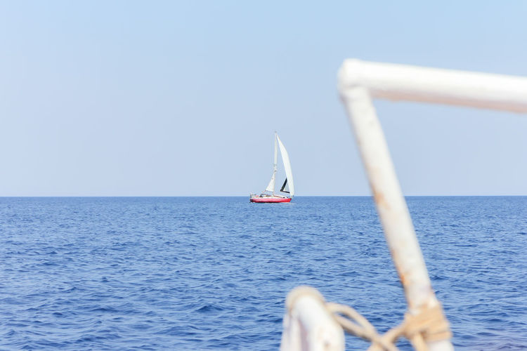 Sailing off the Greek island of Zakynthos Greek Islands Beauty In Nature Blue Clear Sky Day Horizon Horizon Over Water Mode Of Transportation Nature Nautical Vessel No People Outdoors Sailboat Sailing Scenics - Nature Sea Selective Focus Sky Tourism Tranquil Scene Tranquility Transportation Water Yacht Yachting