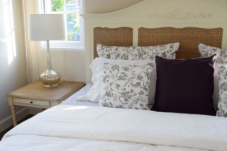 High angle view of cushions on bed at home