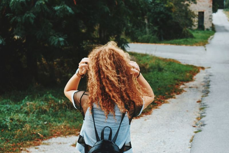 Savage Redhair Red One Person Hairstyle Real People Hair Long Hair Lifestyles Leisure Activity Young Adult Focus On Foreground Young Women Outdoors Women Nature Plant Three Quarter Length Road Brown Hair Rear View Casual Clothing Day