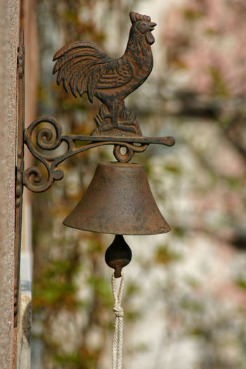 Bell Cocktail Door Bell Natural Light Natural Colours Silhouette Antiques Bookcover Call Daylight Doorbell Entertainment Focus On Foreground Handmade Italy Liguria Metal Metallic Nature On Background No People Old Outdoors Ring Rooster Rusty