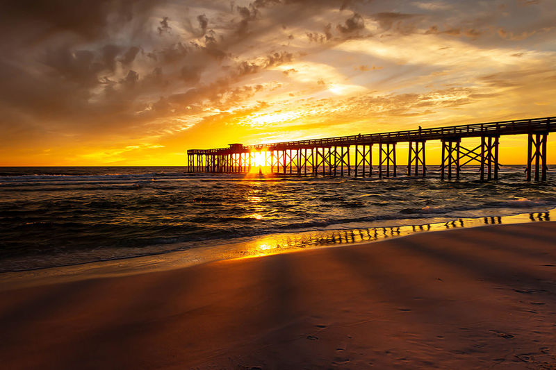 Sunset Water Sky Sea Cloud - Sky Scenics - Nature Beach Built Structure Beauty In Nature Connection Bridge Orange Color Land Nature Architecture Tranquility Pier Bridge - Man Made Structure Tranquil Scene No People Horizon Over Water Outdoors Architectural Column