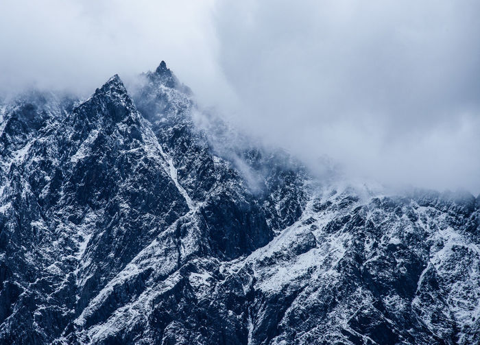 Close-up of mountains against sky during winter