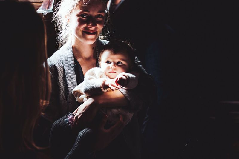 illuminated baby with its mom Light In The Darkness Illumination Illuminated Baby Babyhood Real People Child Lifestyles Togetherness Indoors  Emotion Capture Tomorrow Portrait Two People Family Parent Bonding Young Women