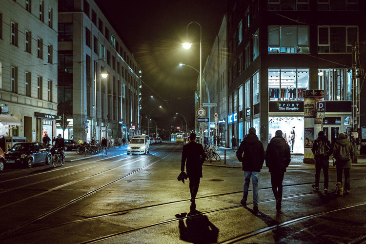 People in city at night