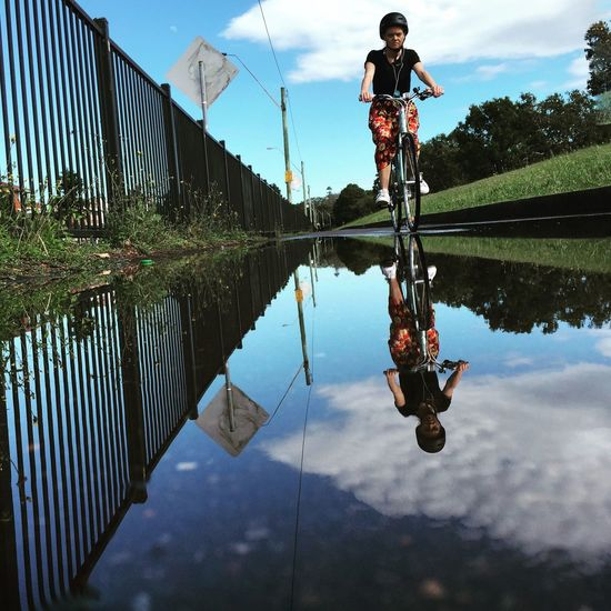 After a rainy day.. Water Reflections Streetphotography People Photography IPS2016Street IPhoneography Girl Cycling