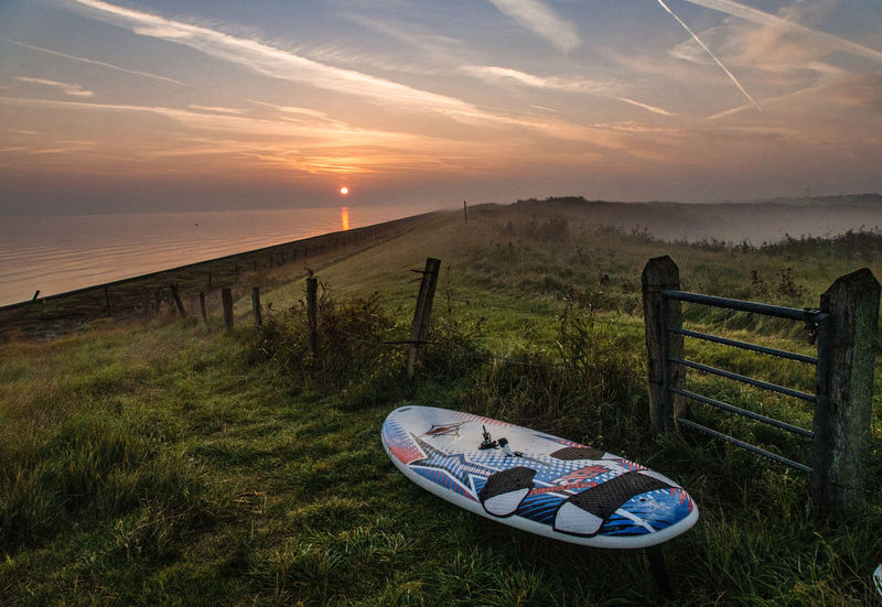 Beauty In Nature Idyllic Tranquility Tranquil Scene Heaven Clouds And Sky Beautiful Scenery Beautiful Morning Foggy Morning Sunrise Early Morning You And Me Seite An Seite Scenics Scenery Abschalten Mit Dir An Meiner Seite! Travel Northsea Surfboard Water Sea Sky Grass Horizon Over Water Calm Coast