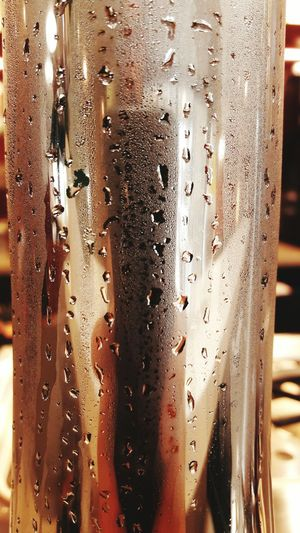 EyeEm Selects Refreshment Drink Water Drop Close-up Cold Drink Drinking Glass Condensation Food And Drink Cold Temperature Wet Indoors  Backgrounds Beer Day Cola Alcohol Freshness No People Frosted Glass The Week On EyeEm EyeEmNewHere Full Frame Mode Of Transport Indoors  RainDrop Window