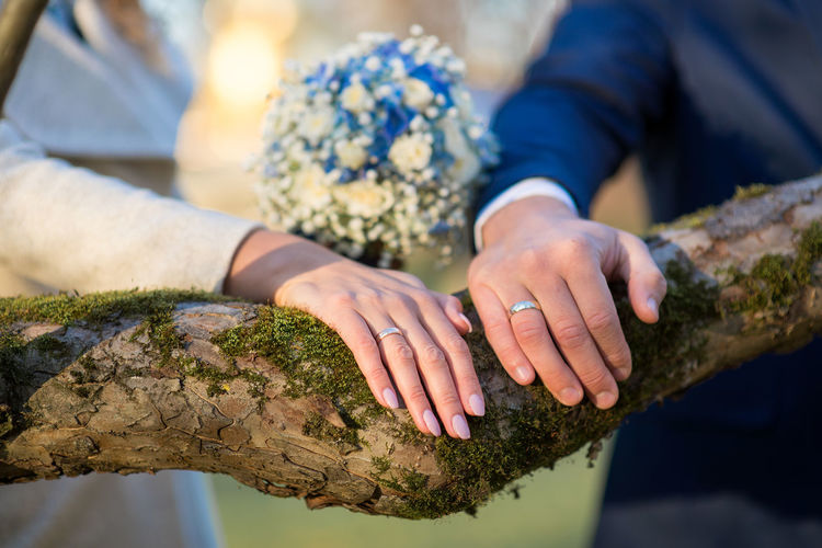 Close-up of the hands of a couple in wedding day