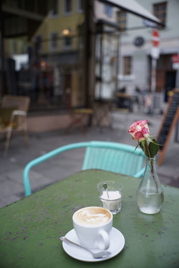 Coffee served on table at a cafe terrace with vintage furniture