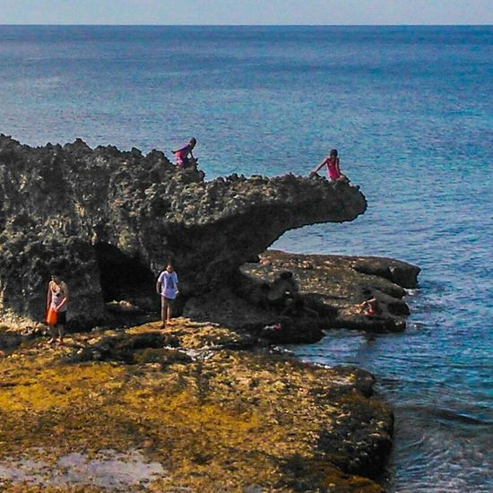 Vacation time around the beach of patar with a couple of people who visit the area. Sea Water Outdoors Beach Beauty In Nature Wave People Sky Day Nature Mammal Adult Real People Animal Themes Beauty In Nature Focus On Foreground Lifestyles Enjoying Life Hanging Out Leisure Activity . Taken at patar, bolinao philippines November2016