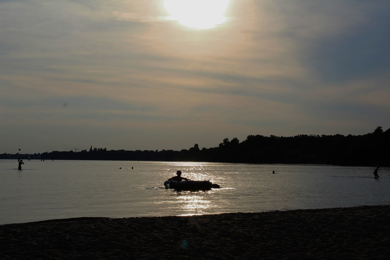 SILHOUETTE BOAT IN SEA AGAINST SUNSET SKY