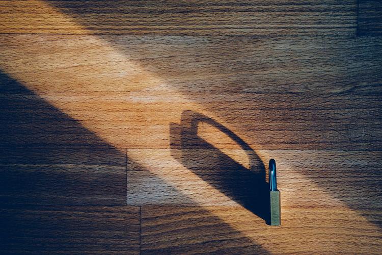 High angle view of shadow on table
