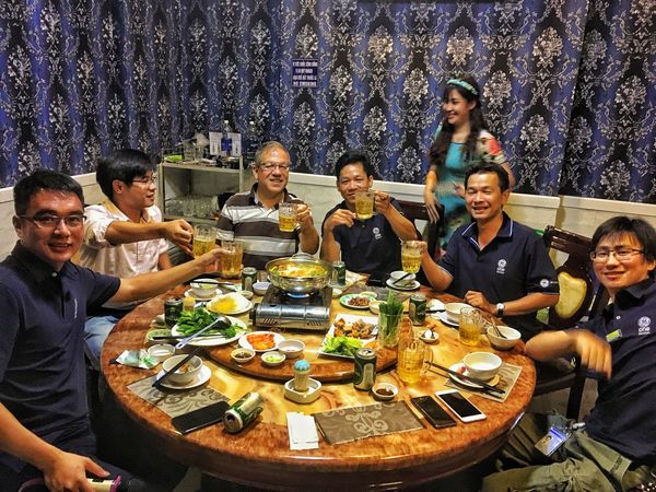 Vietnam Togetherness Friendship Sitting Happiness Group Of People Alcohol Large Group Of People People Young Women Adult Portrait Men Food Young Adult Indoors  Eating Social Gathering Happy Hour Adults Only Day