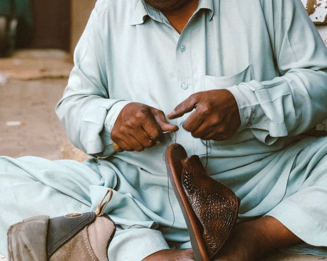 The struggle for a happy life for a Pakistani man working in leather stitching in Jazan, Saudi Arabia Real People Midsection One Person Adult Indoors  Healthcare And Medicine Front View Patient Women Lifestyles Baby Sitting Human Hand Young Holding Men Hand Hospital Close-up