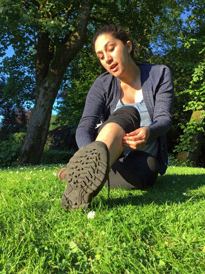 Boots Casual Clothing Excursion Grass Grassy Leisure Activity Lifestyles Nature Outdoors Portrait Relaxation Trekking Walker Walking Boots Woman