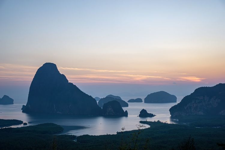 Morning sunrise. Mountains in the Andaman Sea. March 2019: Samed Nang Phi Phang Nga, Thailand South Thailand Phang Nga Sun Sunrise Sunset Nature Atmosphere Morning Dawn Mountain Sky Clear Sky Yellow Sky Water Sea Ocean Outdoor Parks Beautiful Beauty View Landscape Outlook Spectacle Scene Scenery Scenic View Seascape Vista Wide View Environment Environmental Horizon Horizon Over Water Horizontal Horizontal Lines Natural Scenics - Nature Beauty In Nature Tranquil Scene Tranquility Rock Idyllic No People Rock Formation Rock - Object Solid Non-urban Scene Headland Outdoors Land Stack Rock