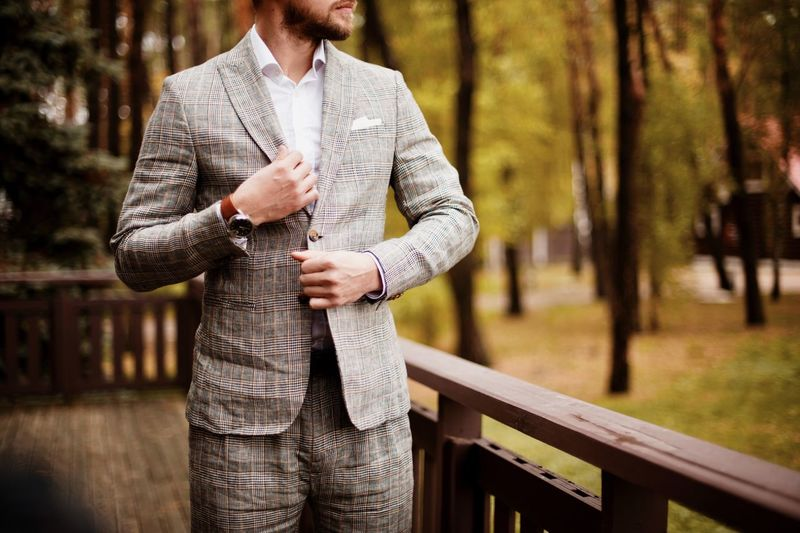young man in suit Adult Clothing Day Focus On Foreground Forest Front View Hand Land Leisure Activity Men Nature One Person Outdoors Plant Railing Real People Standing Tree Wood - Material Young Adult