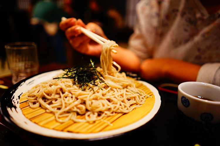 Close-up of soba noodles served in plate on table