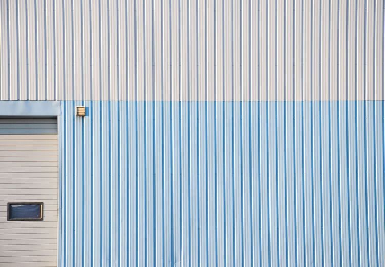 WhiteBlue Minimalism Facade Detail Door Façade Façade Pattern Architecture Built Structure No People Blue Wall - Building Feature Full Frame Backgrounds Building Exterior Day Closed Metal Corrugated Iron Iron Striped Textured  White Color The Architect - 2018 EyeEm Awards