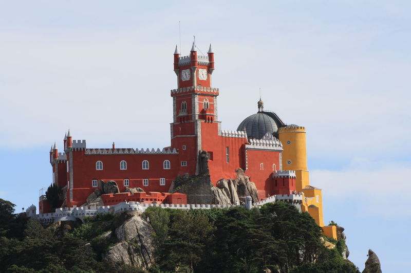 Architectural Feature Architecture Blue Building Exterior Built Structure City Day Exterior Growth Lisbon Sintra Low Angle View No People Outdoors Pena Palace Sintra (Portugal) Sintra Palace Park Sky Tall - High Tourism Travel Destinations Tree