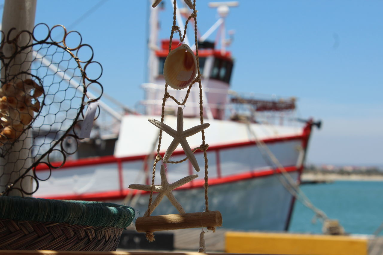 Close-Up Of Decor Equipment Against Fishing Boat